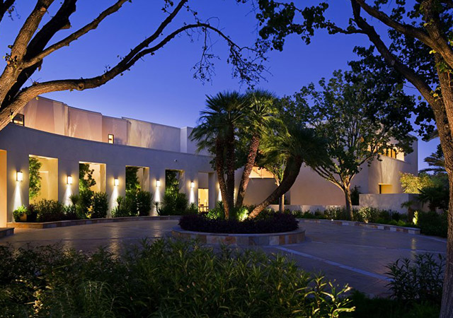 Elegant exterior home entry, circular driveway and drought-tolerant landscaping in Henderson, Nevada